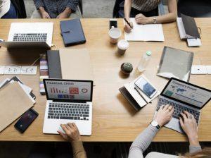 4 KPO workers with laptop showcasing their KSAs