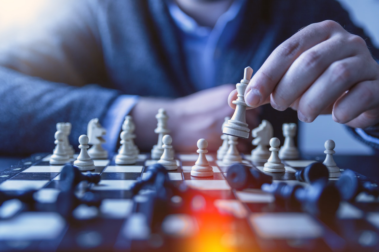 Man relating chess with using outsourcing services benefits for business