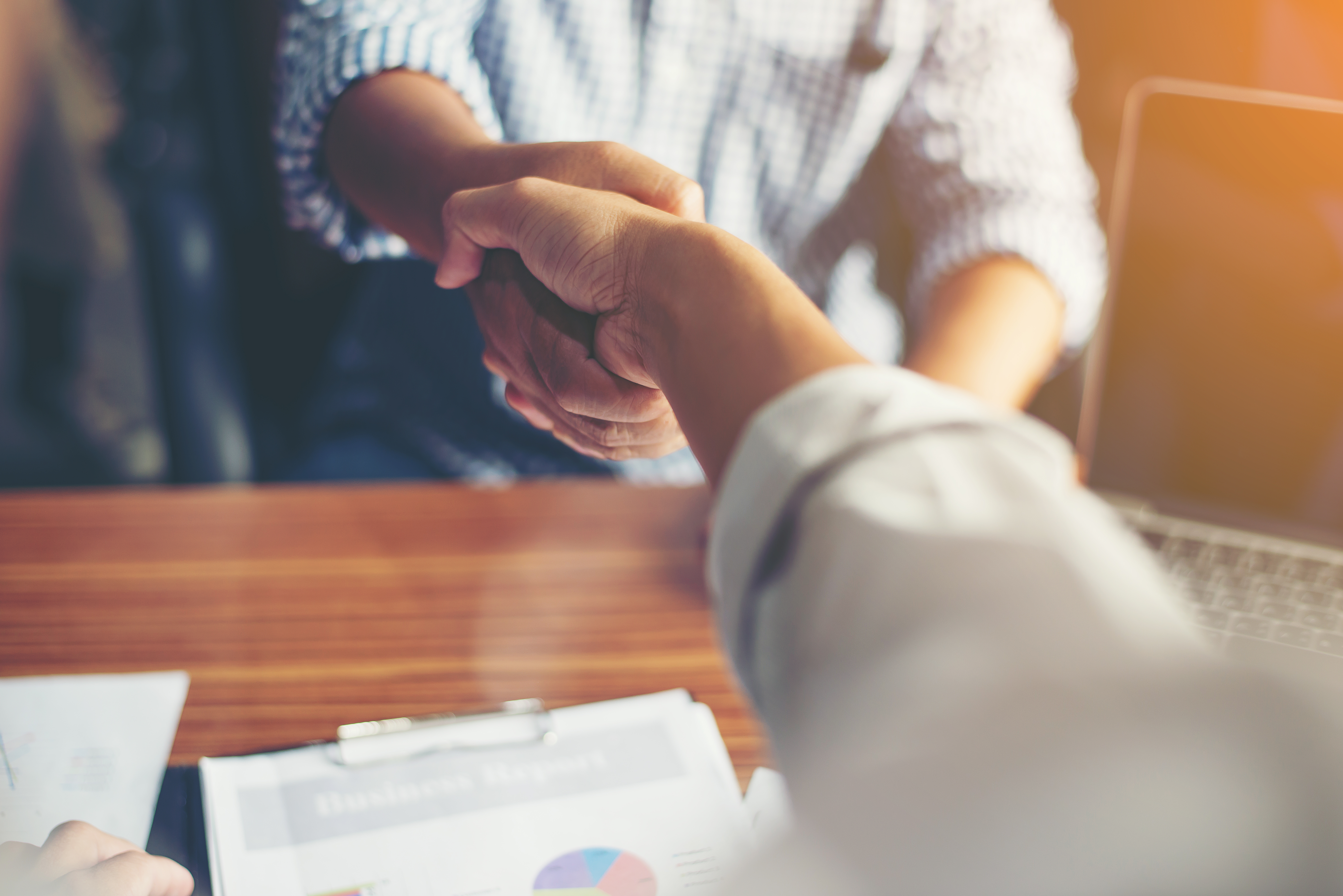 a meeting for outsourcing tips for businesses with handshaking