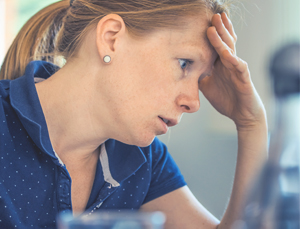 female employee having a work-related stress