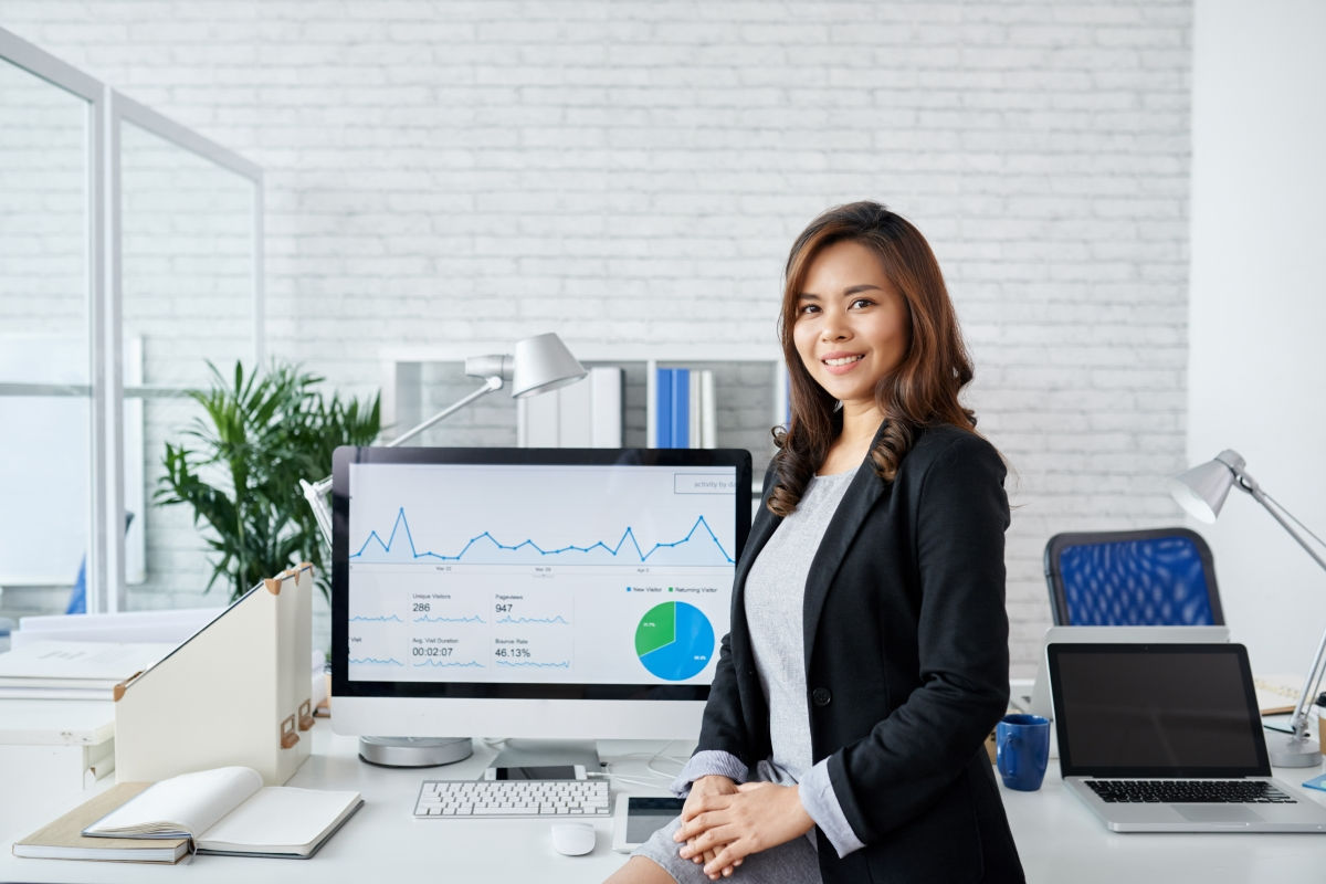A Filipina professional in an office in the Philippines, a top outsourcing location