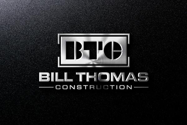A metal btc letter logo for bill thomas construction