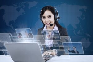 A virtual assistant using her laptop to provide you reasons to hire virtual assistants