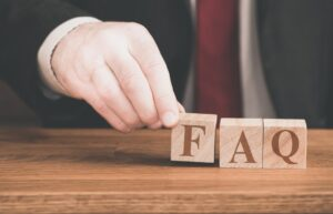 FAQ blocks arranged by hand to represent what is bpo and other frequently asked questions